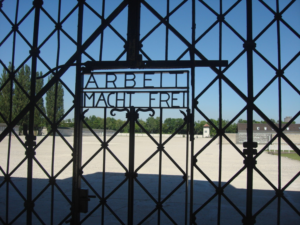 "Gates entering Dachau ""Work sets you free"""